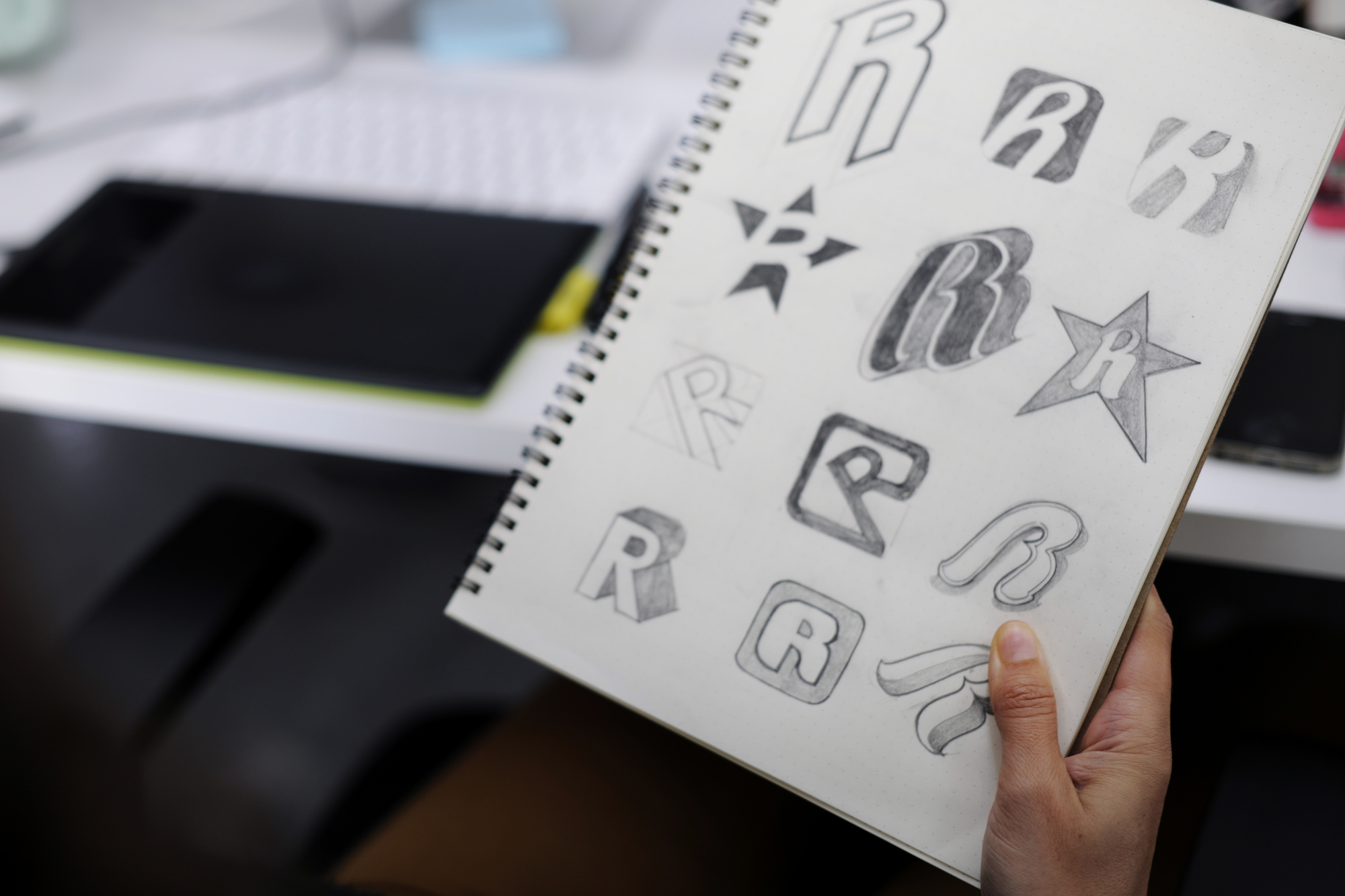 logo sketches on notebook