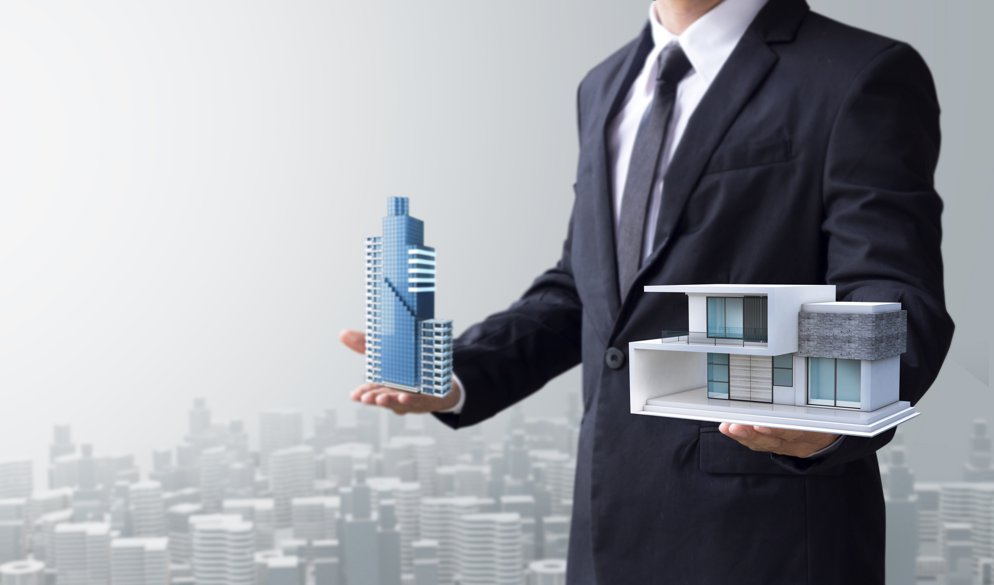 realtor holding model buildings