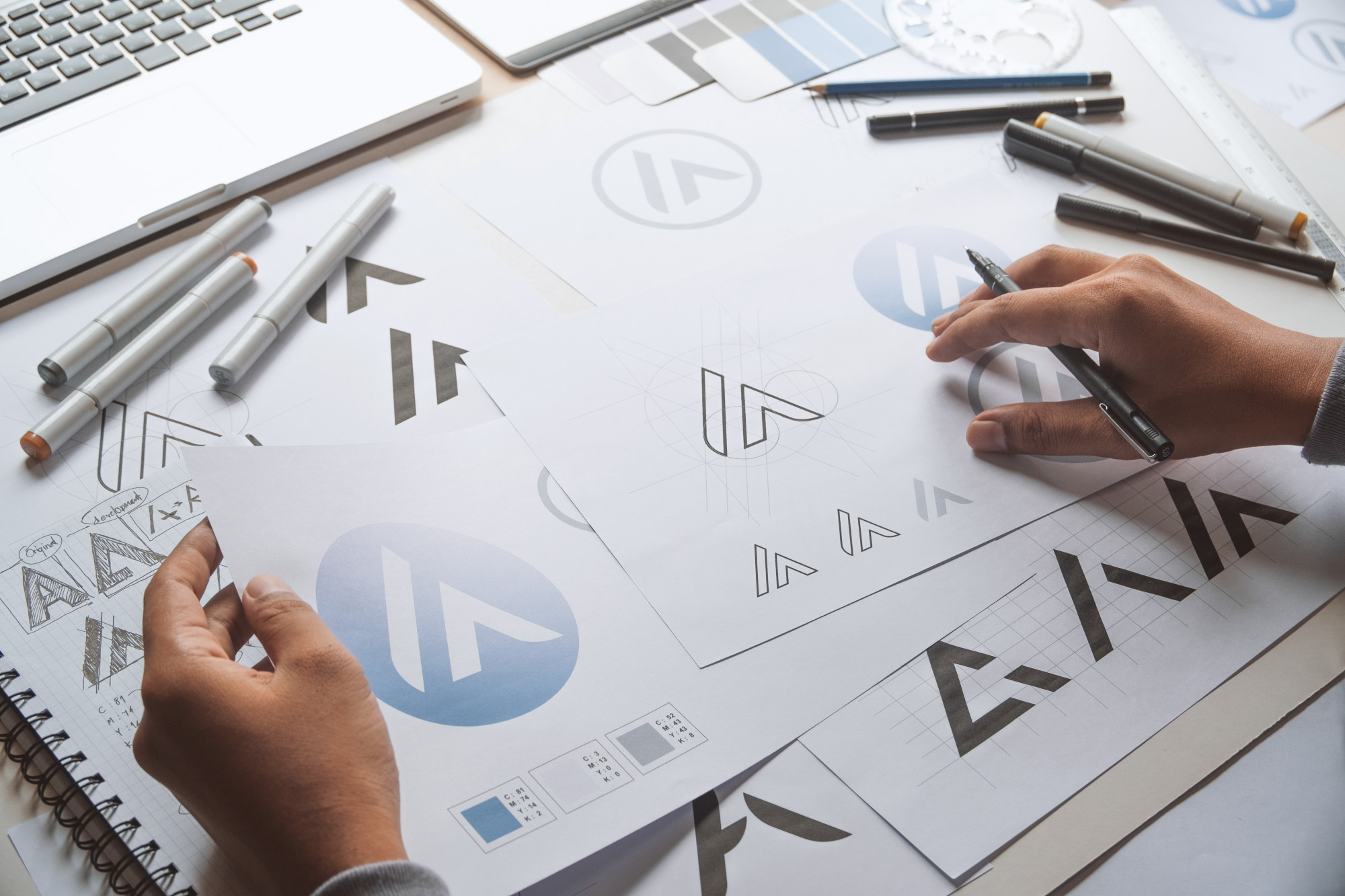 person working on print logo