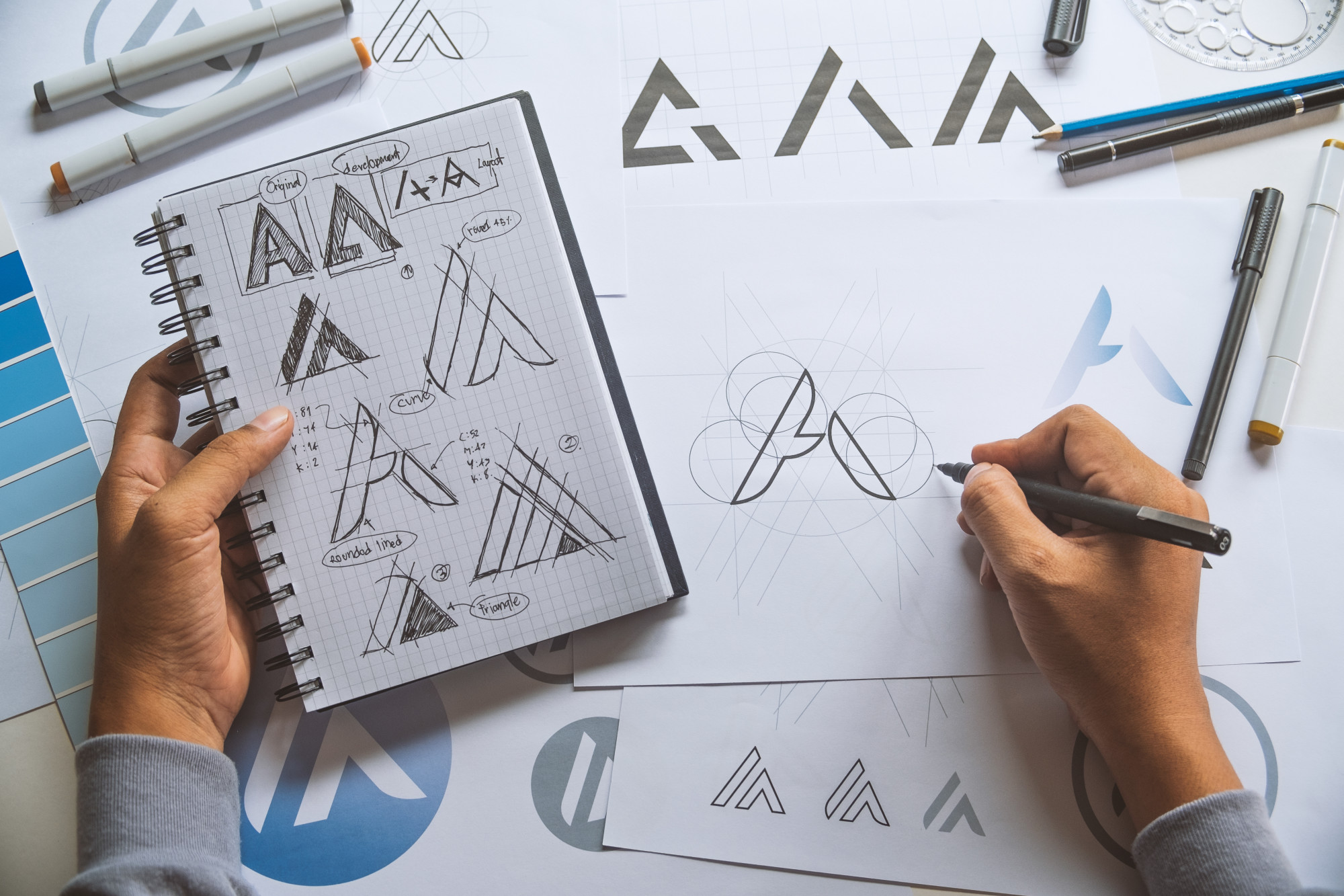 person working on logo design