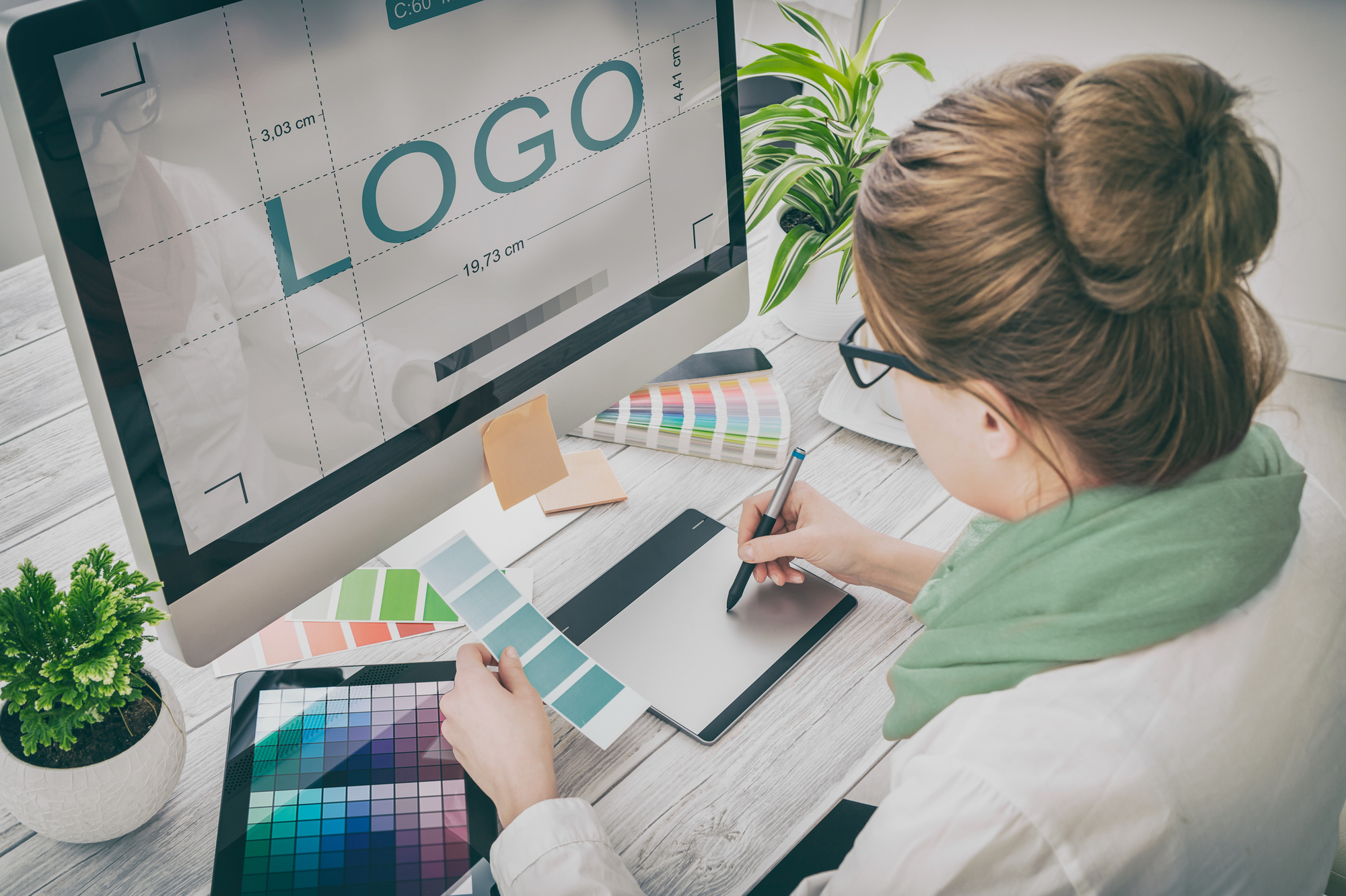 Woman Designing a Business Logo